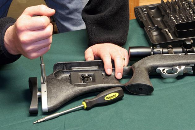 Gunsmith making custom modifications